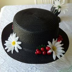 Add flowers and cherries to a hat